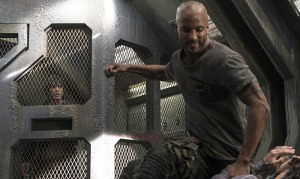 Ricky Whittle and Bob Morley in The 100 (2014)